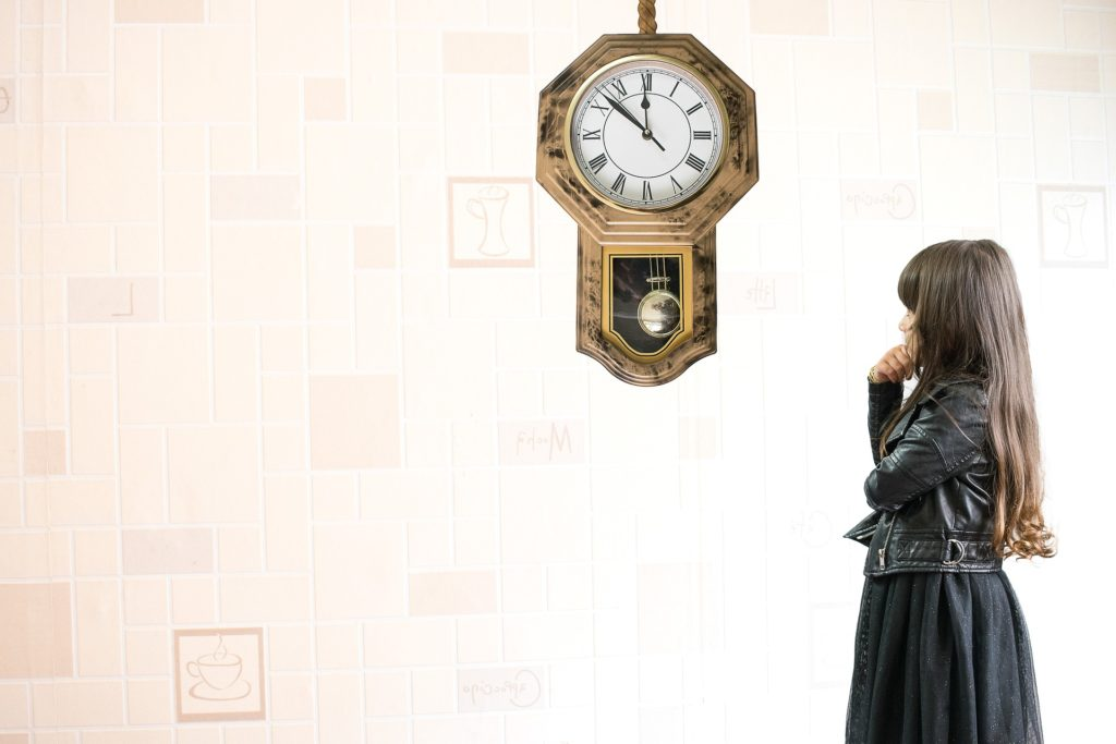 Child looking at a clock for time travel