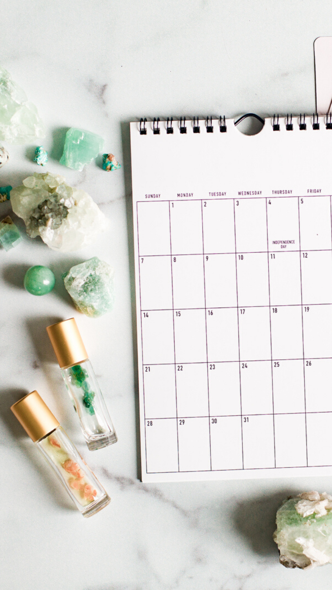 calendar with crystals and essential oils