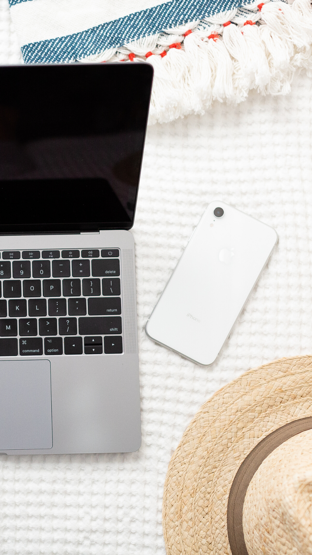 laptop and straw hat and cell phone