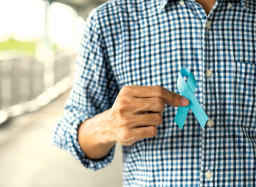 person holding blue ribbon