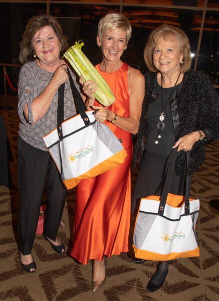 Pam Bieri, Lauren and Edie Keller with guest gift bags for the farmer's market