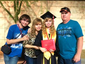 Crystal Harrell and family at her College of the Desert graduation after being diagnosed and put on the right medication.