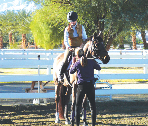 Taking the first step with help from trainer Laurie Cunningham and Shatze