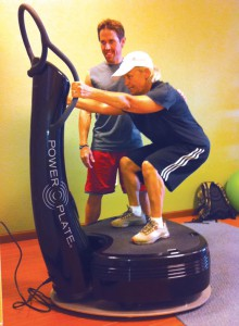 Jay Nixon works with Vicky Harrison on the Power Plate