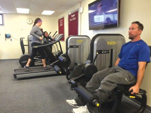 Faculty and staff work out in the new center