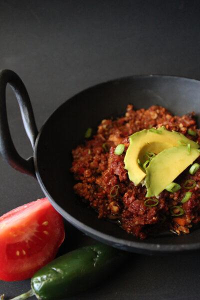 Warm chili with avocado