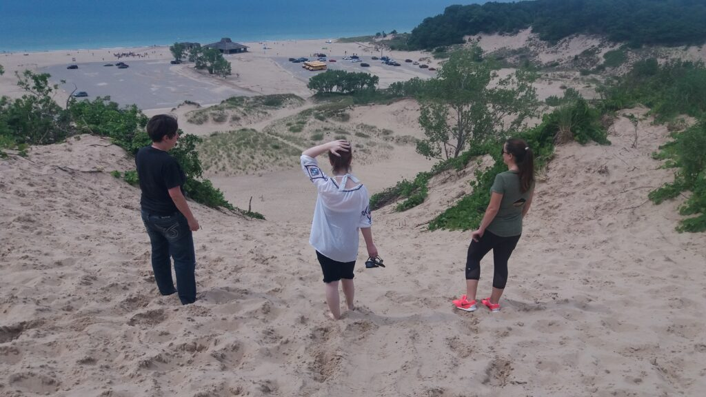 Girls at the top of the dunes