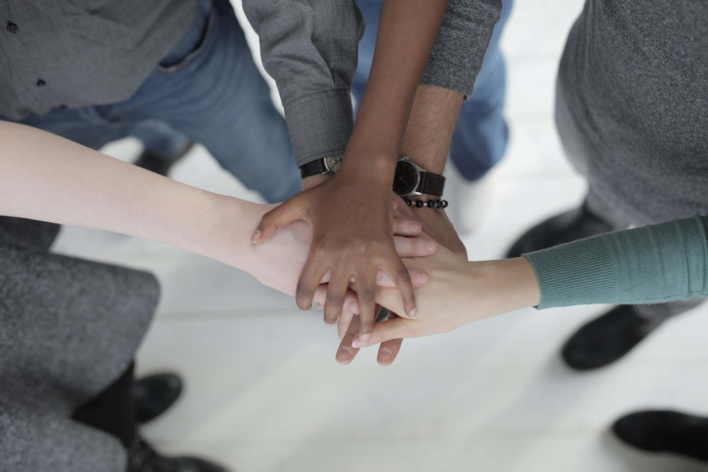 image-of-team-huddle-hands-in-professional-clothes-diverse-career-development