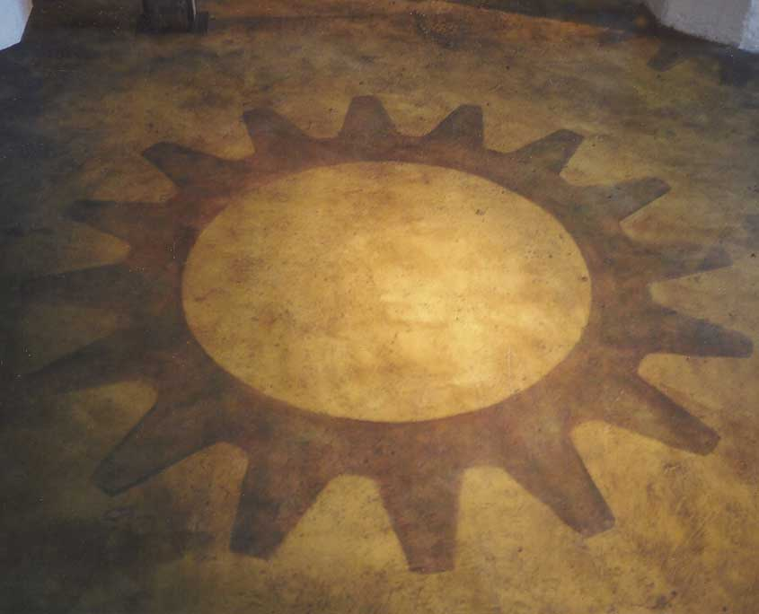 Decorative floor painting faux finish and large gear graphic