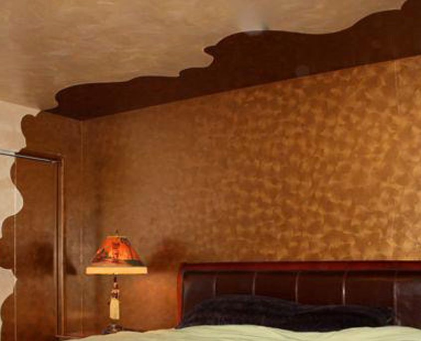 Copper metallic decorative painting on wall of bedroom