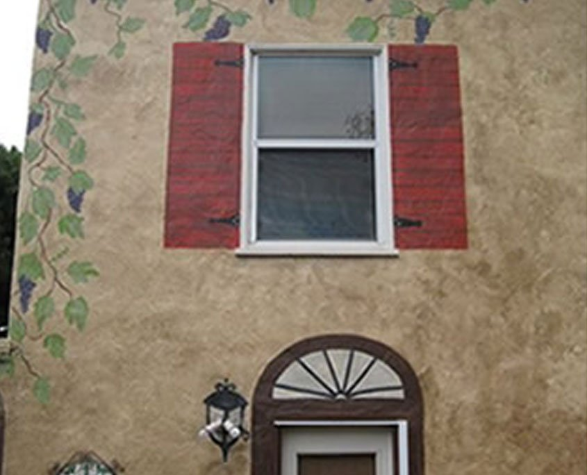 Exterior decorative painting mural of vines and shutters on Tuscan house