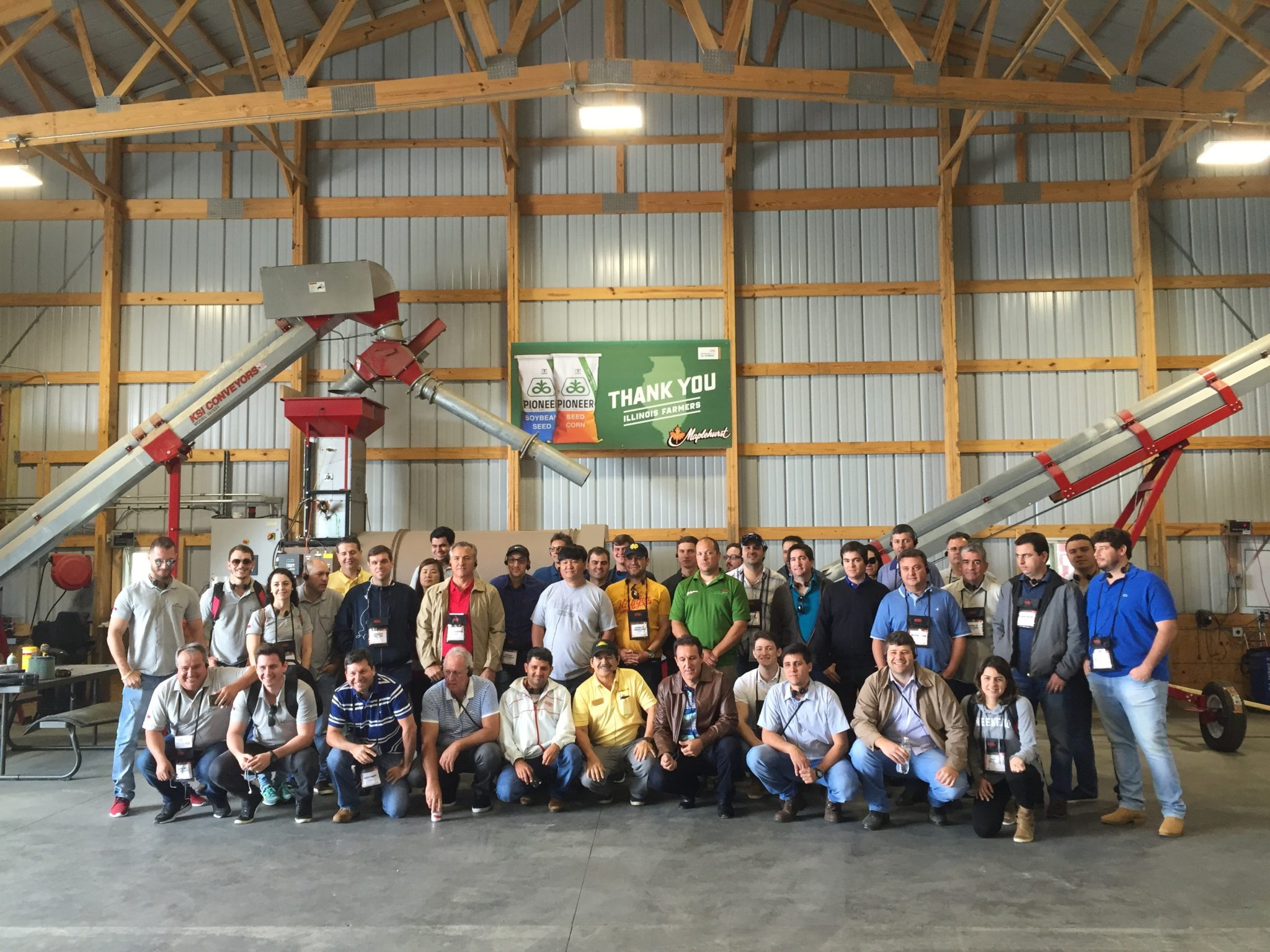 agtours.us tour group in barn with farm equiptment