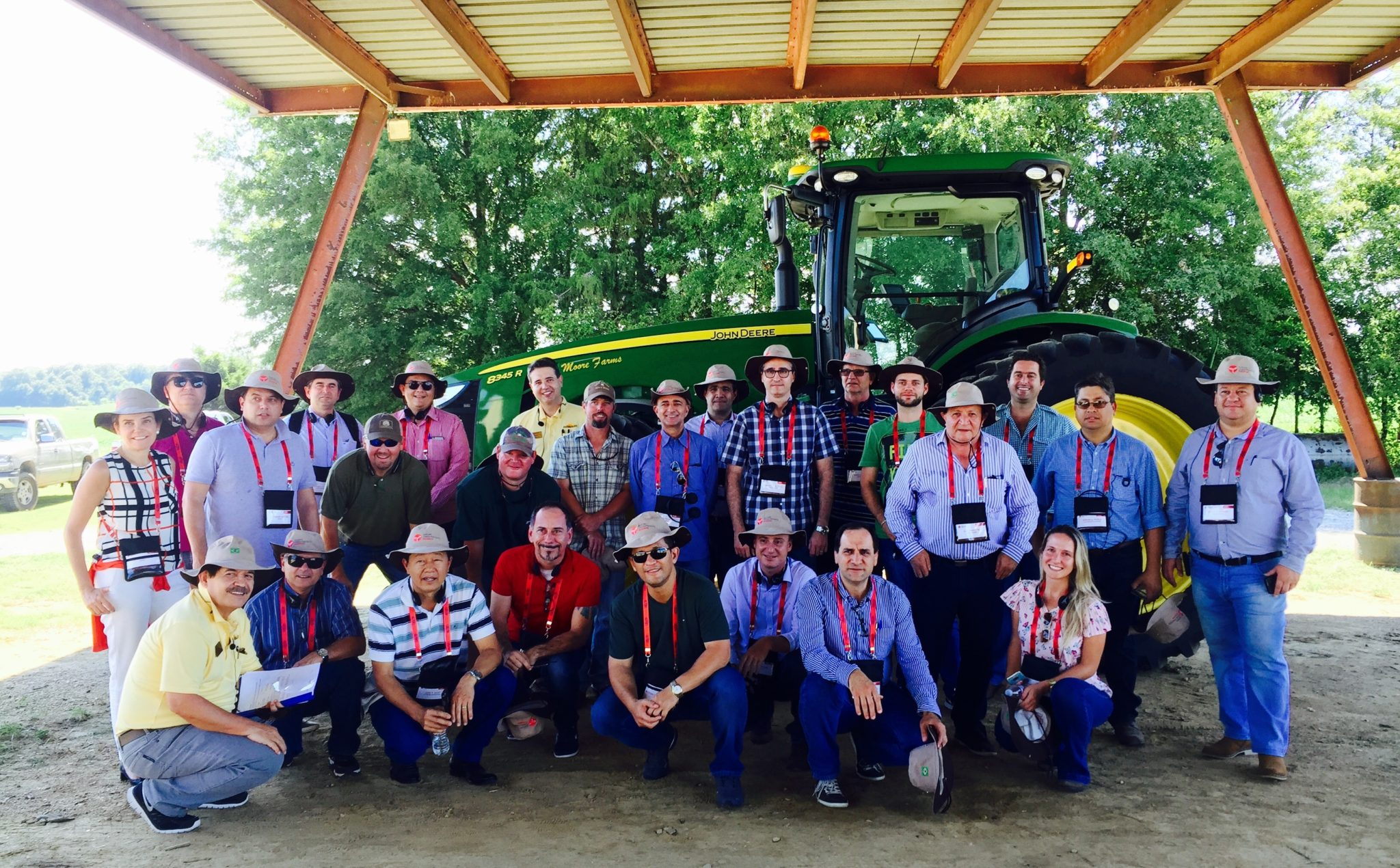 agtours.us tour group farm under open barn by a john green tractor
