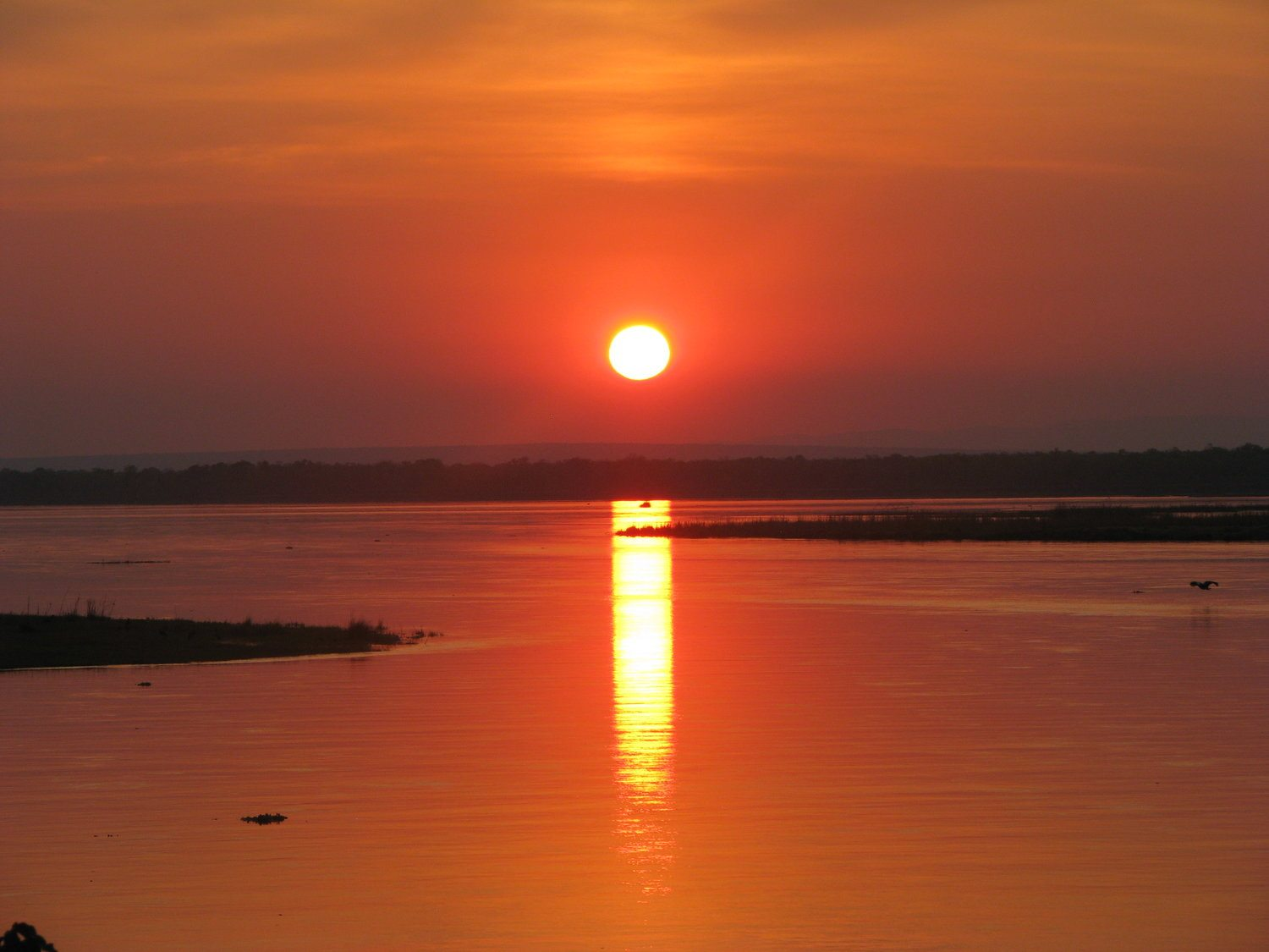 Kenya sunset over a water view