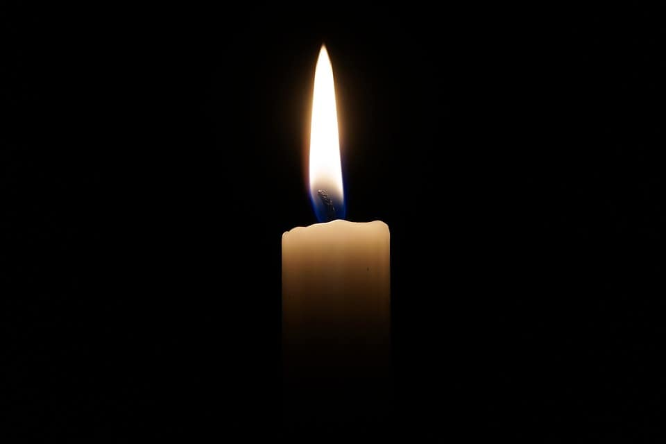 photo of a candle remembering woman who died after jumping from bridge following an auto accident in Corpus Christi. Injured in a car accident? Contact personal injury lawyer in Corpus Christi Minesh J. Patel today.