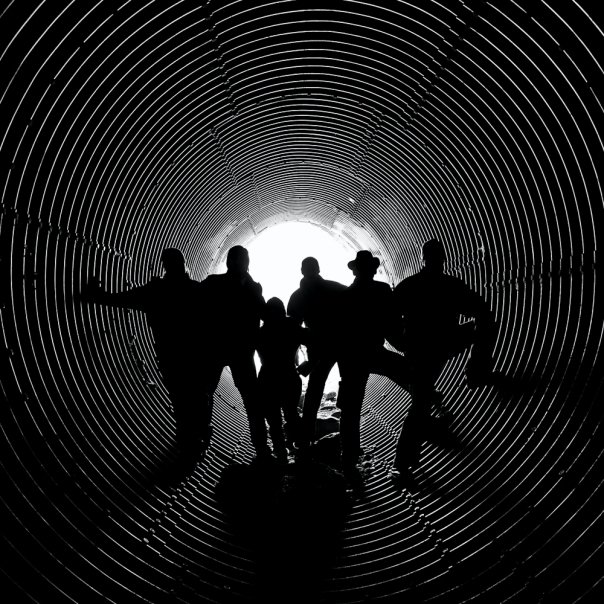 crew portrait in tunnel backlit