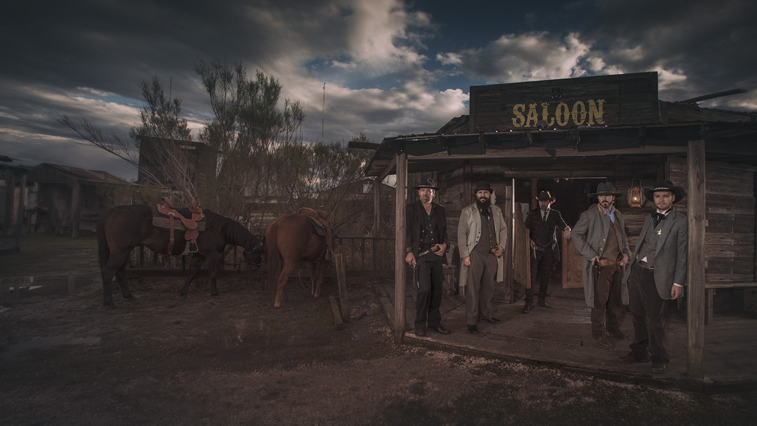 gang of men outside saloon western Wild West at J Loraine Ghost Town