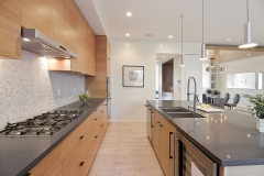 Galley kitchen with rift white oak cabinets. Book match grains,