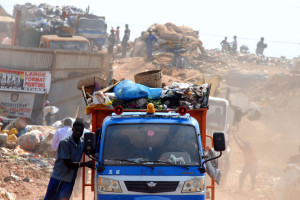 Image: Three and four wheeler vehicles transporting waste to dispose in an open dumpsite in Accra, Ghana; Photo: Seth
