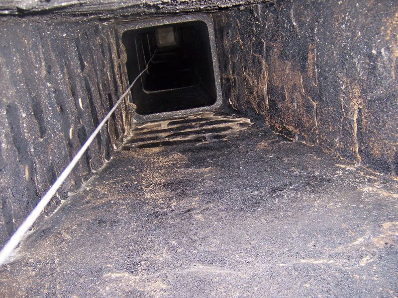 Damper Cable in Smoke Shelf and Flue Liner
