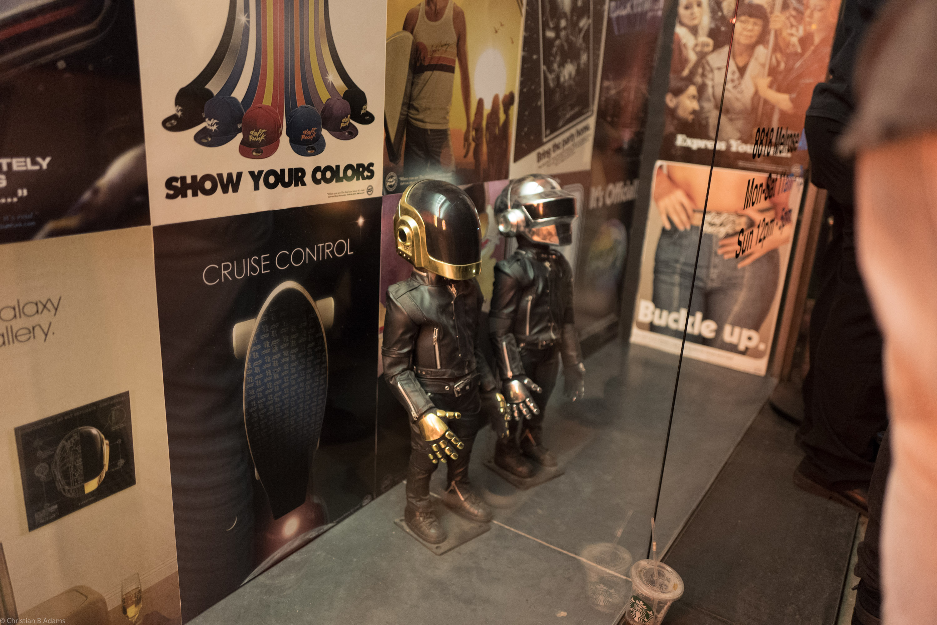 ~24 inch robot dolls watch the line outside Maxfield Gallery for the Daft Punk Pop Up in February of 2017