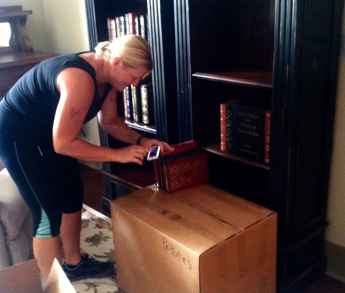 Senior move manager packing boxes