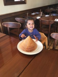 Kid enjoying pyramid dosa