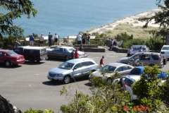 View down to the parking lot from the Yaquina Bay Lighthouse