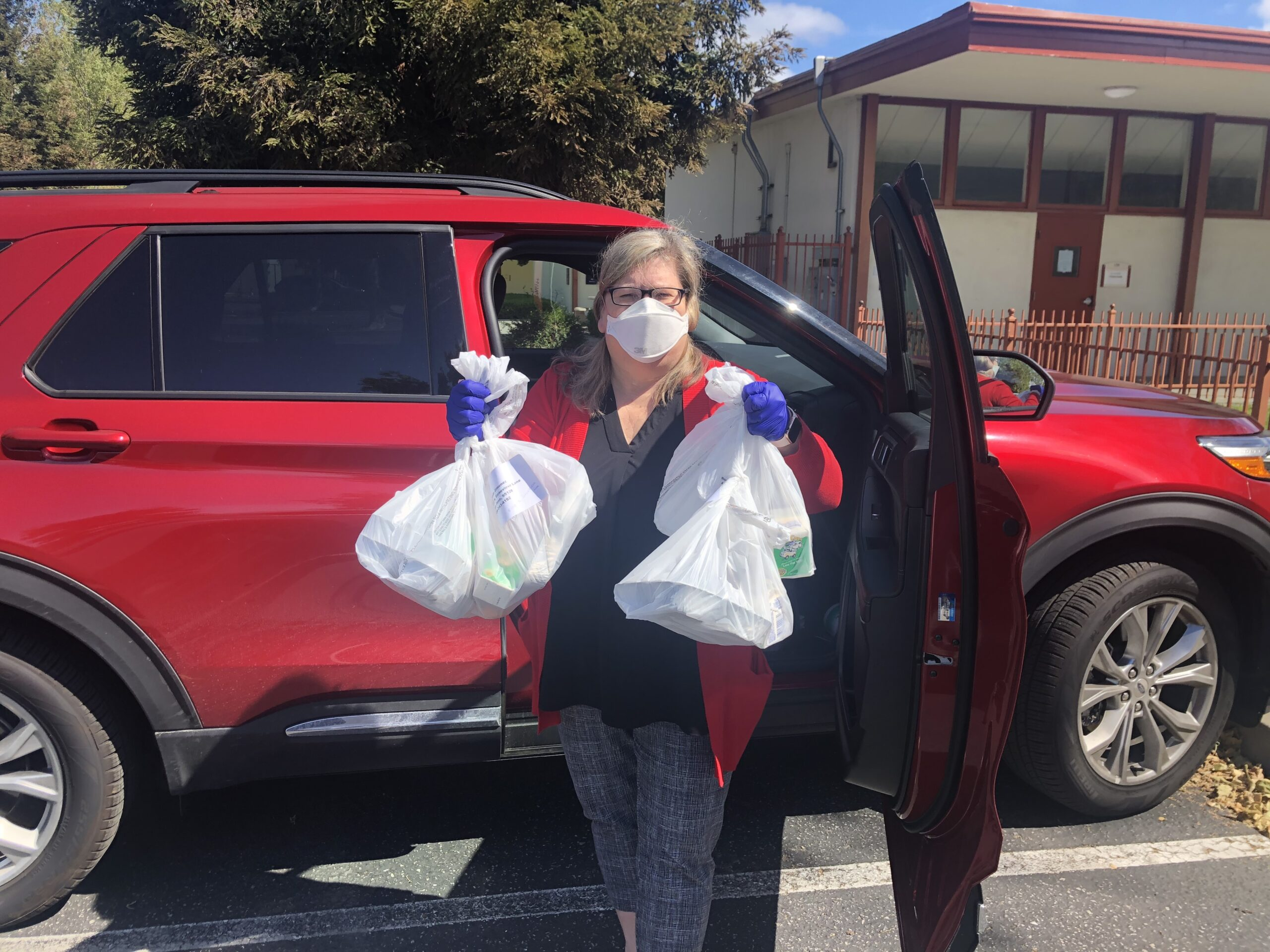 Anne delivering hot meals to seniors during the shelter in place