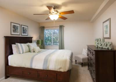 Master Bedroom with Ceiling fan, cabinet, frames on the wall