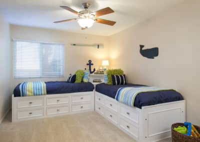 Nautical themed bedroom with two twin sized beds