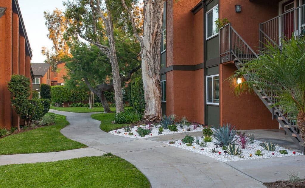 Walkways with lush landscaping near outdoor stairs