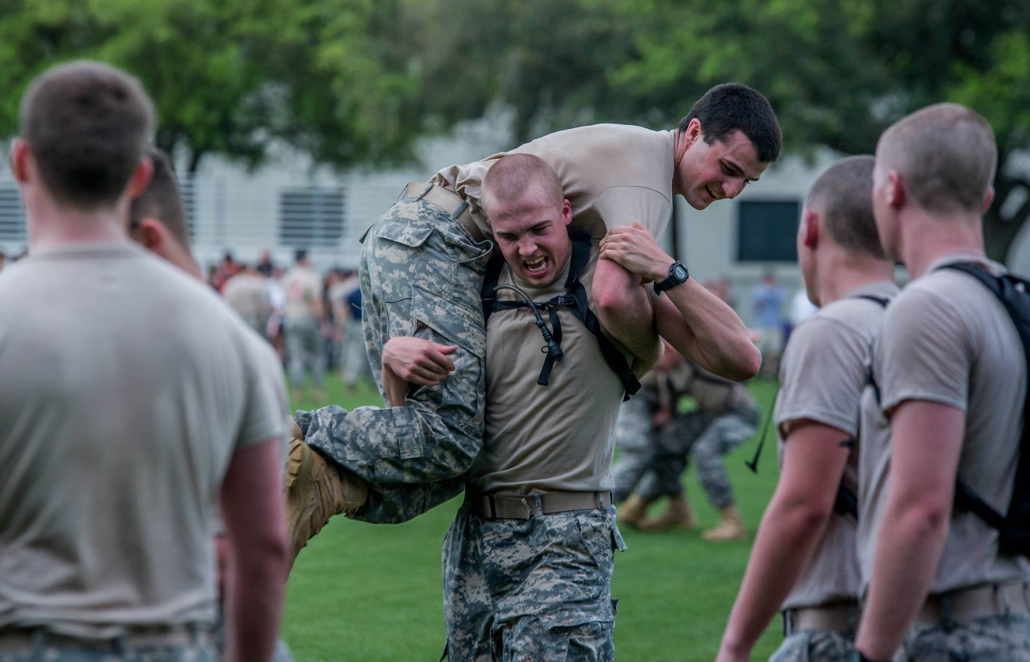 "A 4th Class cadet carries and upperclass cadet at one of the stations during the ""Gauntlet."""