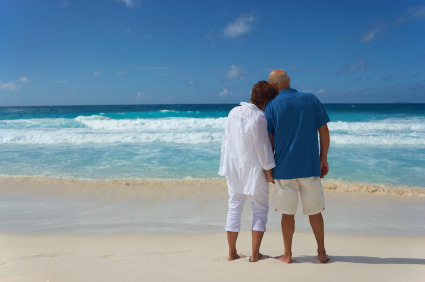 senior couple looking over the sea