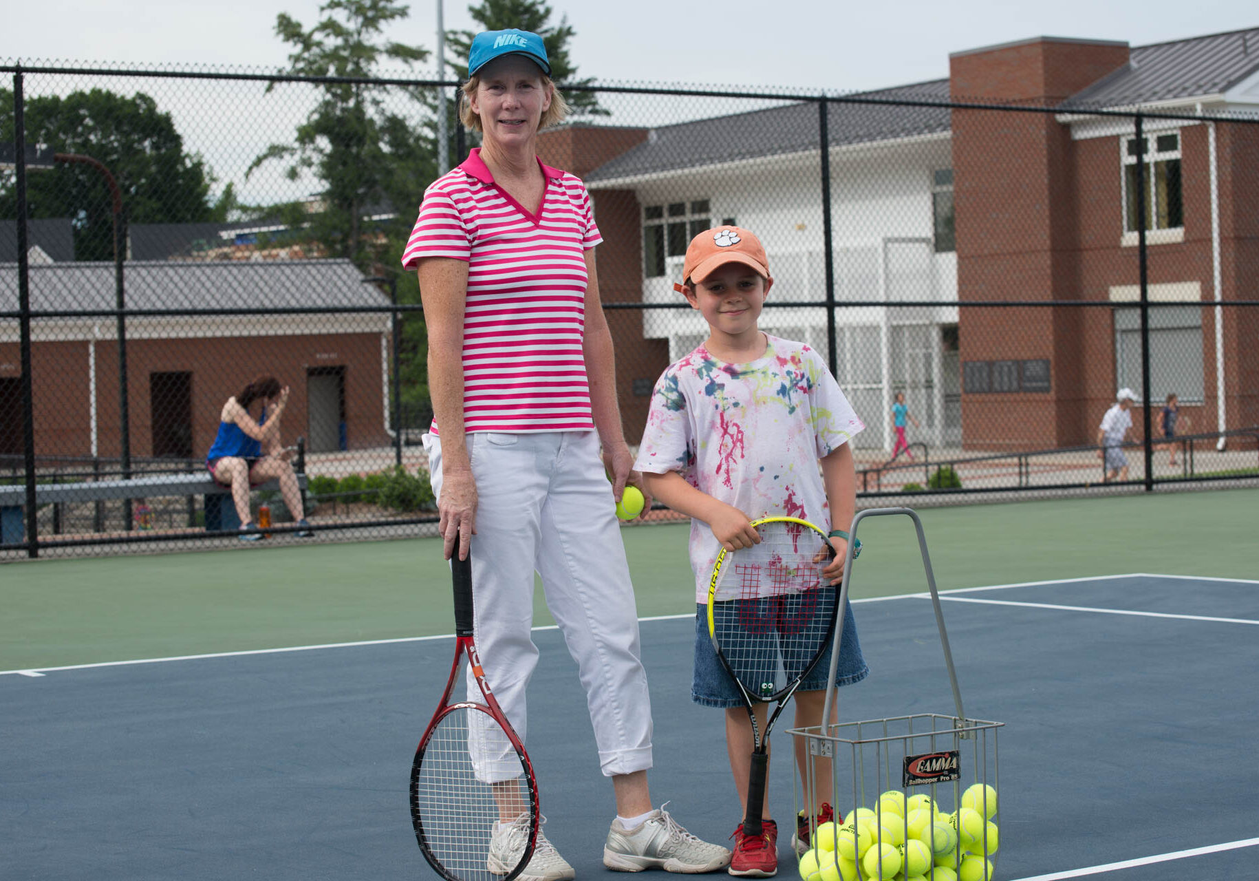 Board member Susan Amonette with a student during the Youth Tennis Clinic