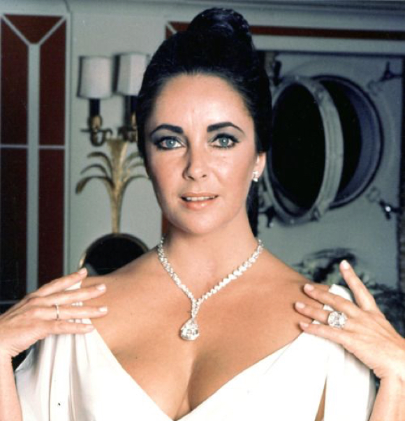 Elizabeth Taylor wearing her largest and smallest diamonds