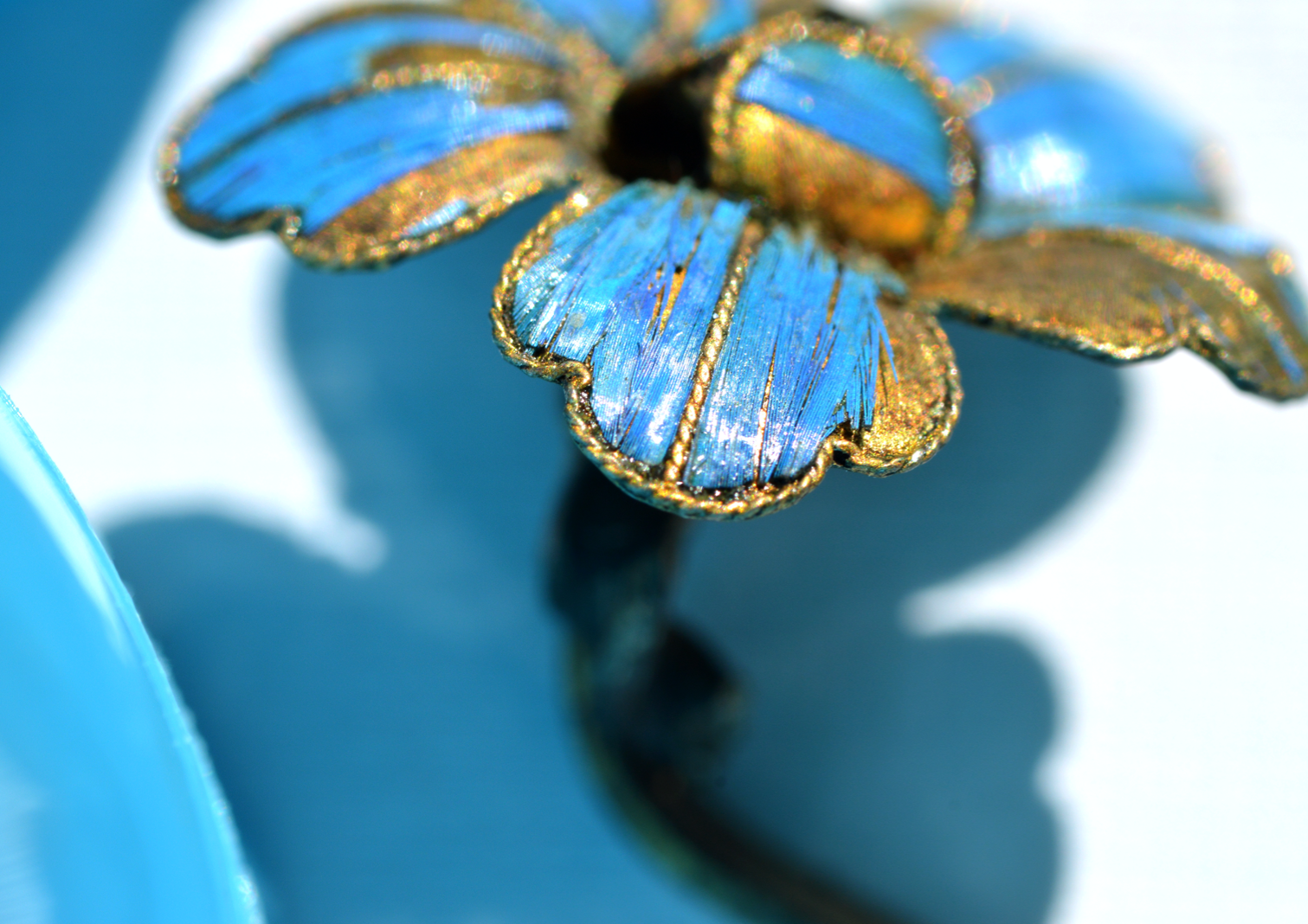 Tian-tsui jewelry made of intense blue kingfisher feather hairpin in a floral motif showing the close-up detail of the feather.
