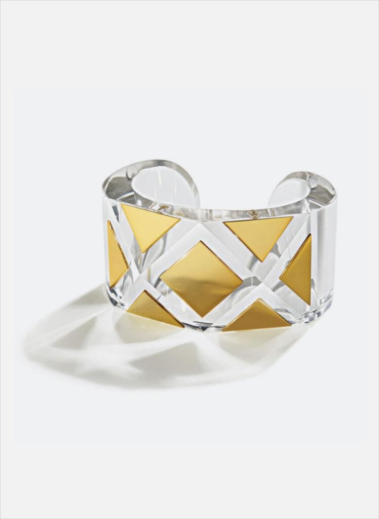 Women in gold belperron cuff