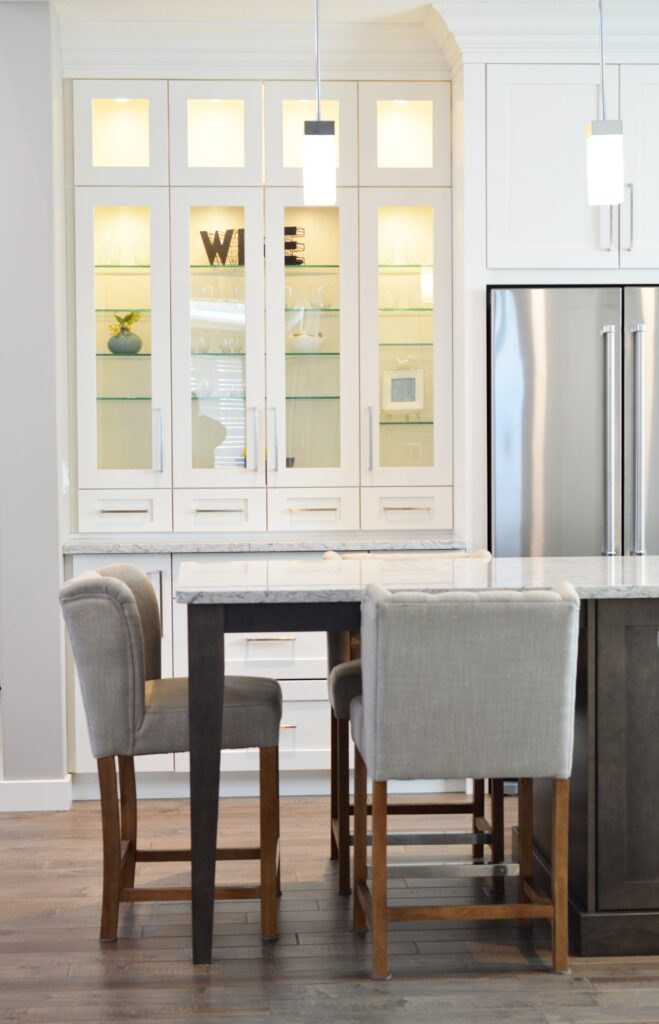 White kitchen remodel with custom lit built in cabinets