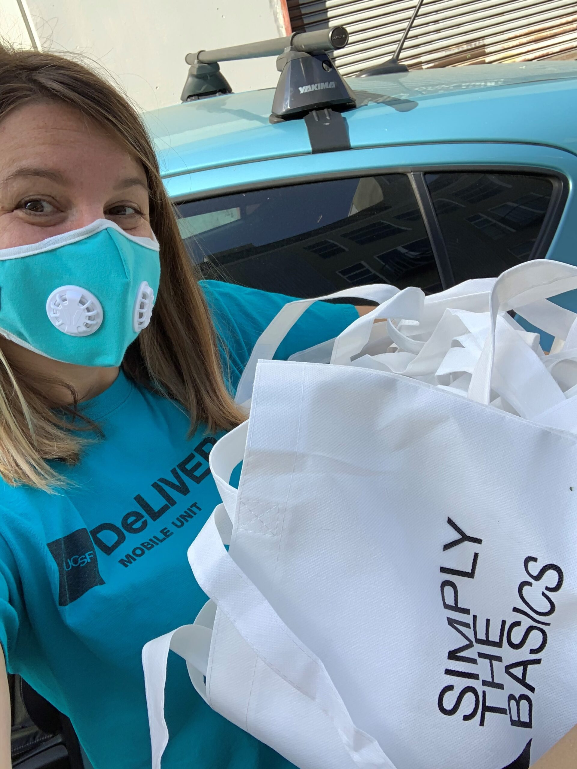 Rachel delivers hygiene packs while practicing social distancing