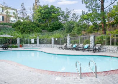 Paved pool with chairs and gate