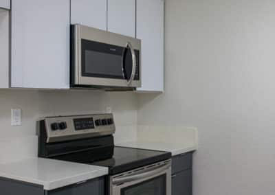 Stainless Steel Appliances, white countertops and cabinetry