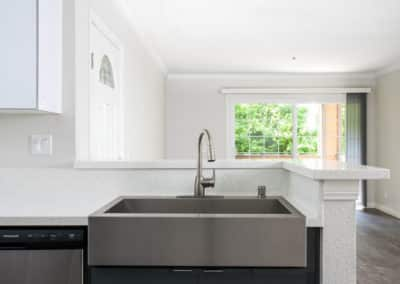 Stainless Steel Sink in the kitchen that opens to the living room