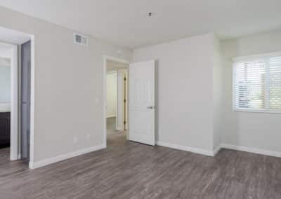 Wood-Style flooring throughout the apartment with white walls and doors