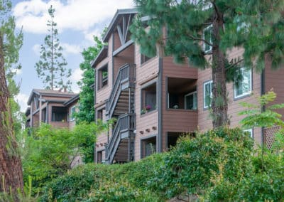 Exterior of Crestwood Apartment Homes with landscaping and trees