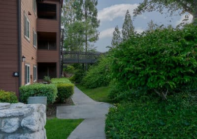 Landscaping and garden pathways along the exterior of apartment building