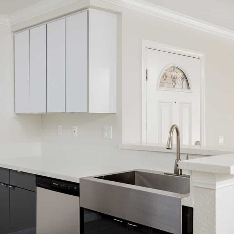 Stainless Steel Sink and white kitchen cabinets