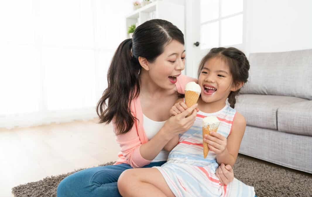 Mother and Daughter eating ice cream together