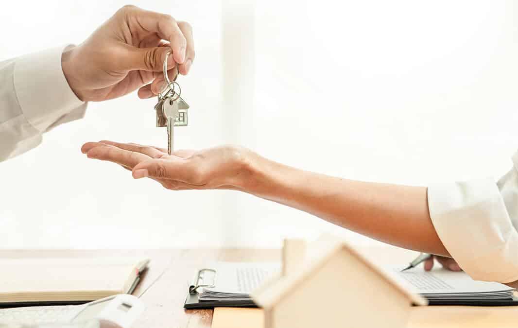 person handing keys over