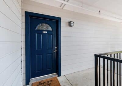 Apartment entrance showing fresh painted door and building